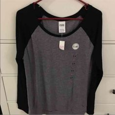 PINK Victoria's Secret longsleeve NWT PINK Longsleeve. Size medium. Gray and black im color. Cheaper on Mer cari! PINK Victoria's Secret Tops Tees - Long Sleeve