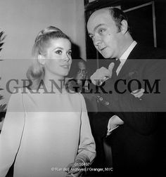 This is a Granger licensable image titled 'RAPPENEAU AND DENEUVE. French director Jean Paul Rappeneau presenting his film A Matter of-Resistance january 26, 1966 here with his actress Catherine Deneuve. Full credit: AGIP - Rue des Archives / Granger, NYC -- All rights reserved. ' by GRANGER All rights reserved. You may not copy, publish, or use this image except for sample layout ('comp') use only. You must purchase the image from Granger in order to use it for ANY other...