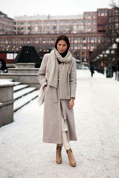 Fashion: New York City Style. Long, dove grey, tie-waist coat.