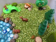 Create & play with this simple forest animals sensory bin based off a fun nature book! Perfect for toddlers or preschoolers learning about the forest!