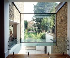 Split-level space in London by Giles Pike architects Architecture Details, Interior Architecture, Interior And Exterior, Glass Extension, Extension Ideas, Basement House, London House, Amazing Spaces, House Windows