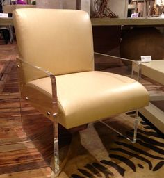 """I Love Lucy ... the incredible chair from Tritter Feefer, not the show.  I'm still feeling the seventies, and this combo of lucite and leather (or pleather, you choose) is simply beyond.  The style leans modern, of course, but would be a great update in a traditional setting.  How can you not love an entirely """"Made in the U.S.A."""" company named after the founders' grandchildren? Yummy.  I think I'll pretend Tritter and Feefer are twins. Tritter Feefer (IHFC Interhall 408B)…"""