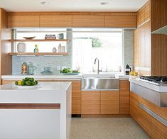 Touch of Sparkle - like the speckled floor material with strong horizontal wood grain in the cabinets.