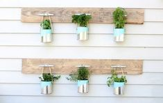 I wanted to create an easy and inexpensive herb garden so I used old paint cans, spray paint, rope, dock cleats and a couple pallet boards to create this DIY he… Jardin Vertical Diy, Vertical Garden Diy, Vertical Gardens, Vertical Planter, Herb Garden Pallet, Diy Herb Garden, Garden Web, Garden Crafts, Pallets Garden