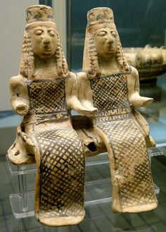 Terracotta model of 2 female figures, perhaps goddesses Demeter and Persephone, seated in a cart, Corinthian, Thebes?, c600 BCE