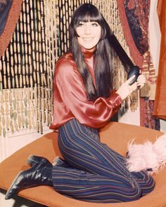 Cher 60s rock n roll looks boots pants striped satin shirt blouse top red blue black color photo print ad singer model star long hair psychedelic beatles looks