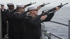 Sailors assigned to the Ticonderoga-class guided-missile cruiser USS Chancellorsville (CG 62) render a 21-gun salute on the starboard bridge-wing of the ship in honor of Veterans Day.