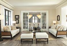 upholstered cane sofas | tan & black palette | gray hardwood floors