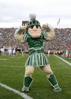 Brian Spurlock-USA TODAY Sports Sep 21, 2013; South Bend, IN, USA; Michigan State Spartans mascot flexes his muscles during the game agains...