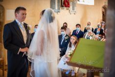 Flower girl and covid mask wearing wedding guests watch bride and groom exchange vows during church of England wedding ceremony. Church Wedding Ceremony, Church Of England, Vows, Groom, Bride, Watch, Flower, Wedding Bride, Clock