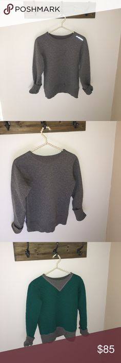 * NEVER WORN* Sweatshirt by Brooks! Two Looks! Never worn! This awesome pull over has two different looks- reversible in grey and a beautiful forest green! Great for casual or working out! It's a great outdoors running sweatshirt too! Brooks Tops Sweatshirts & Hoodies