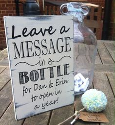 Handmade wooden sign. This hand distressed sign reads: Leave a message In a Bottle For name & name to open In a year The sign is