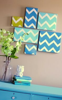 Make your own Chevron Artwork! Take shoe box lids paint them white. Add painters tape to create the Chevron pattern. Then paint over the box lid with your color of choice! Your very own art work! :)