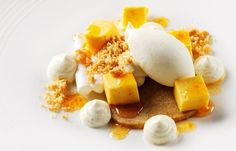 Sea buckthorn curd meringue with yoghurt sorbet and wholemeal shortbread. Vegetarian recipe.