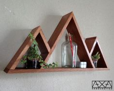 This is our Three Mountains wall shelf made from reclaimed wood. The nail holes create a uniqueness and the aging of the wood presents a beautiful Wall Decor Design, Shelf Design, Reclaimed Wood Furniture, Diy Furniture, Wood Crafts, Diy Crafts, Geometric Shelves, Diy Wood Wall, Wood Shelves