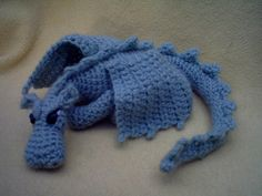 Ravelry: Fierce Little Dragon pattern by Lucy Ravenscar. I am trying to learn how to crochet because I want to make my little man a dragon, eventually. This little blue dragon is especially cute. Crochet Dragon Pattern, Crochet Amigurumi Free Patterns, Free Crochet, Crochet Baby, Knitting Patterns, Knit Crochet, Ravelry Crochet, Crochet Monsters, Crochet Animals