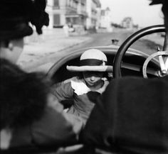 Jacques-Henri Lartigue, Jeanine Dupuis under the soft top of her father's pic-pic, La Baule, 1915.