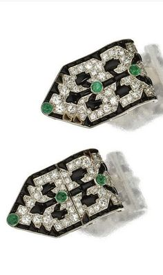 Pair of art deco diamond, onyx and emerald earclips, French - Of modified arrow shape, decorated with stylized tree motifs, set with calibré-cut onyxes, round cabochon emeralds and single-cut diamonds weighing approximately 2.00 carats, mounted in platinum, plaques are circa 1925. | © 2015 Sotheby's