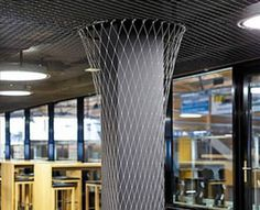 Stainless steel ferrule rope mesh is covered on a pillar and the ceiling of hall.