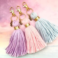 Mermaid Goddess charm tassel keychains with chunky gold glitter trim! Available in lilac, blush pink, or soft blue. Makes a dreamy addition to your planner. Handmade Keychains, Diy Keychain, Glitter Ribbon, Gold Glitter, Gold Nails, Diy Tassel, Tassels, Blush Pink, Lilac