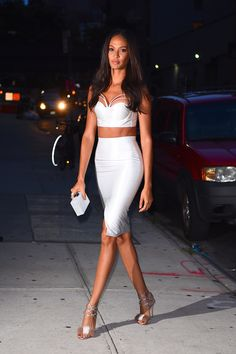 Joan Smalls flaunted her insane physique in a form-fitting white two-piece set that also exposed her incredible abs. Sexy, strappy sandals with fur details and a box clutch completed her sexy look. (Photo by Robert Kamau/GC Images)  via @AOL_Lifestyle Read more: http://www.aol.com/article/2016/08/18/sexy-stars-lady-gaga-shanina-shaik-and-more-stun-in-sultry-sty/21454577/?a_dgi=aolshare_pinterest#fullscreen