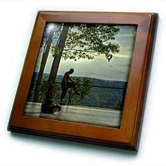 "2 dancers, on outdoor platform stretching - 8x8 Framed Tile by 3dRose. $22.99. Solid wood frame. Dimensions: 8"" H x 8"" W x 1/2"" D. Inset high gloss 6"" x 6"" ceramic tile.. Keyhole in the back of frame allows for easy hanging.. Cherry Finish. 2 dancers, on outdoor platform stretching Framed Tile is 8"" x 8"" with a 6"" x 6"" high gloss inset ceramic tile, surrounded by a solid wood frame with pre-drilled keyhole for easy wall mounting."