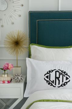 Love the headboard color and monogrammed pillow