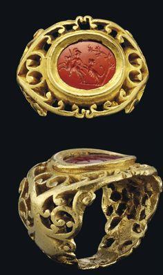 A ROMAN GOLD AND JASPER INTAGLIO RING CIRCA 2ND-3RD CENTURY A.D.