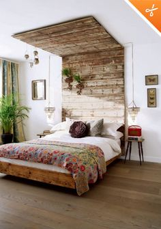 Love the barn-board headboard to ceiling accent. Fantastic juxtaposition with the glamorous small chandeliers... I can just hear my mom say this is too adventurous!