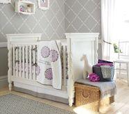 white crib skirt with gray trim