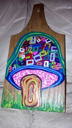Mushroom cutting board. Quick piece for Parks. He just loves it. Done with paint marker.