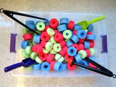 I'm not sure if I saw this exact idea on pinterest, but I have been learning lots of ways to use pool noodles, so I made this sensory bin for the toddlers out of them! They enjoyed using the scoops and tongs too - great fine motor practice! And we even got to introduce colors!