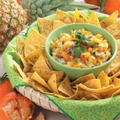 Fast Fruit Salsa Recipe  8oz can Crushed Pineapple - drained  8oz can Mandarin Orange - drained & chopped  1/4 C. Red Onion - chopped  1T. Fresh Cilantro Leaves - chopped  Mix & serve with Tortilla Chips (good over Grilled Fish, Chicken or Pork)