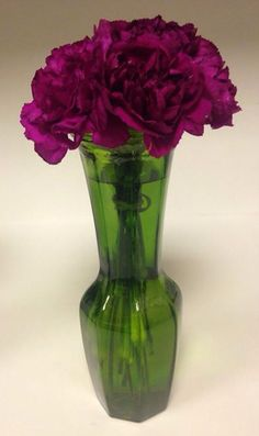 Purple carnations in green vase. Joker themed flowers.
