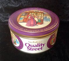 A vintage 1lb Quality Street tin, which contained assorted chocolates and toffees, made by Rowntree Mackintosh in 1990.  Tin is 5.5 in diameter and 2.6 tall, it has some minor rust spots inside and out. (see photos)  Please note: We are happy to post our vintage items anywhere in the world. As they would be sent tracked and signed for, we need an address to generate a postage quote. If you would like to order from outside the UK, please message us first and we will find the best postage…
