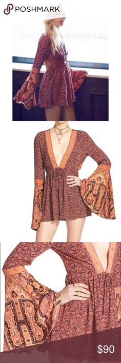 Free People Once Upon A Summertime Boho Romper Showcase your free spirit in a flirtatious romper styled with voluminous bell sleeves, an open back and leg-flaunting shorts. Ties behind neck. Plunging neck. Bell sleeves. 100% rayon. Machine wash cold, line dry. By Free People; imported. t.b.d. Free People Pants Jumpsuits & Rompers