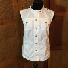 Classy White Vest This is a Ann Taylor white summer vest with a spin on a white jeans jacket.  A more refined white fabric with easy sturdy snap closure.  This is cult to flatter the figure & beautiful tailored seams.  Never worn,  high class look of pricey designers 97% cotton 3% spandex Ann Taylor Jackets & Coats Vests
