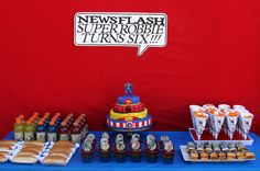 There's no need to pick a favorite superhero when you can combine four or more in one cake. For Robbie's comic superhero party, his mama ensured that all of the superpowers were represented in this four-layer confection! Source: Life Frosting