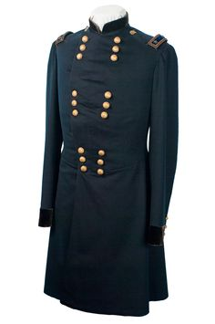 Major General Samuel R. Curtis Frock Coat.  The frock coat was tailor-made, probably in the fall of 1862 when Curtis assumed command of the Department of the Missouri. Shoulder boards with two stars and buttons in groups of three, 3 x 3, for Major General. (Brig. Gen. one star on each shoulder and buttons in groups of two, 2 x 4)