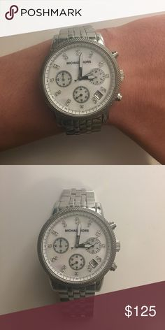 Michael Kors Stainless Steel Watch Stylish and sleek Michael Kors watch. Barely been worn and in great condition! No scratches or marks anywhere on the watch. Michael Kors Jewelry