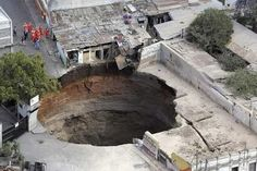 Huge sinkhole, Guatemala City in 2004. Developed after a major storm.