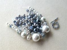 This fun kit features glass pearls that are white and silver/blue. They range in size from 6mm to 14mm.They are matched with AB clear crystal glass beads (6mm), blue glass beads (6mm), rhinestone rondelle spacer beads (12mm), silver metal beads (6mm) and a pewter designer toggle clasp (16mm). This kit would make a great bride or bridesmaid necklace. Must see to appreciate !    All sizes are approximate.    What you see is what you will receive.    You will receive 20 inches of beadalon a...