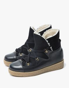 Hiking boot-inspired ankle boots from Ganni. Available in Black or Cognac. Rounded toe. Lace-up front. Suede upper with contrast panels. Chunky platform sole. Sherling lined.  • Leather upper • Rubber midsole/outsole