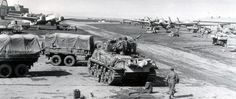 https://flic.kr/p/rXDzz2 | Tanks and vehicles of 6th Armored Division occupy Langensalza near Mulhausen on 7 April 1945. Visible in front of the hangers are some of the airbase's Ju 88 G-6's. | source: www.facebook.com/pages/6th-US-Armored-Division-in-WWII/15...