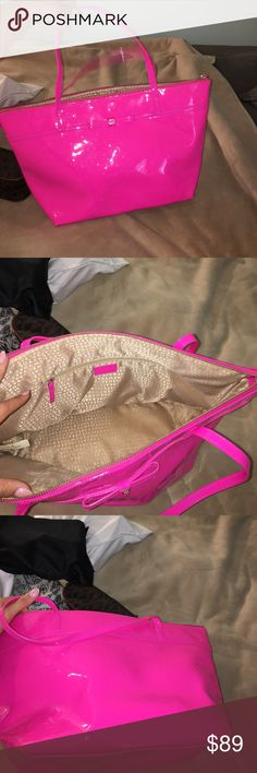 Kate spade tote This is a bright pink Kate spade tote it has a zipper closure in about on the front it's great for traveling fits quite a bit it's in great condition a few scuffs as seen in the pictures nothing noticeable kate spade Bags Totes