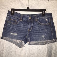 American Eagle Distressed Shorts Great condition American Eagle distressed shorts! Size 2 but they're stretchy, and you can unfold the roll of you iron it! Price is negotiable, make an offer! American Eagle Outfitters Shorts Jean Shorts