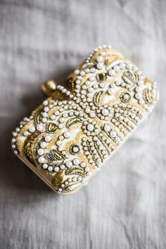 Beauty and the beast inspired beaded clutch: http://www.stylemepretty.com/2016/11/14/how-to-plan-a-beauty-the-beast-inspired-wedding/ Photography: Sally Pinera - http://sallypinera.com/