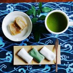 MATCHA at NOON with Sawa-Mochi rice cake and dried sweet potato on Ai Wave Cotton Placemat Sawa-Mochi rice cake is manufactured at Ise city in Mie Prefecture in Japan, where the Ise Shrine is located. Otaue Matsuri Festival is heald on June 24th every year in Izawano Miya which is Gegu in the Shrine. The highlight is that men struggle to win to get a bamboo in muddy rice field. This is a part of praying for a bountiful harvest. This Sawa-Mochi is inspired from the bamboo, which is a symbol..