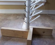 """DIY Monster Bottle Tree w/ pics. For lit tree, drill holes and fit smaller PVC into larger PVC pipe. Stuff lights in """"trunk""""."""