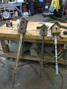 Reclaimed Barn board #birdhouses. The post is made from antique table legs. I just love the one on the right with the vines. Made in WI USA by my dad!